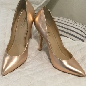 Rose gold leather pumps